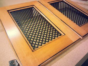 Glazed cabinet door with metal insert