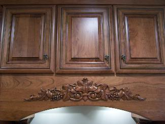 Raised maple cabinet range hood
